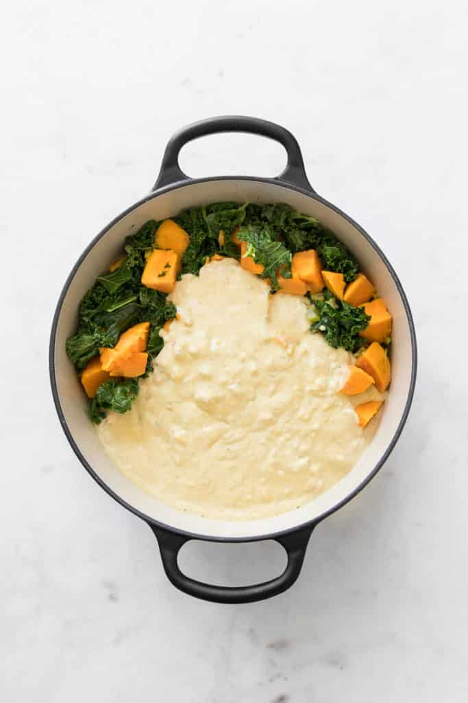 Round French oven with cashew cream sauce, sweet potatoes and kale