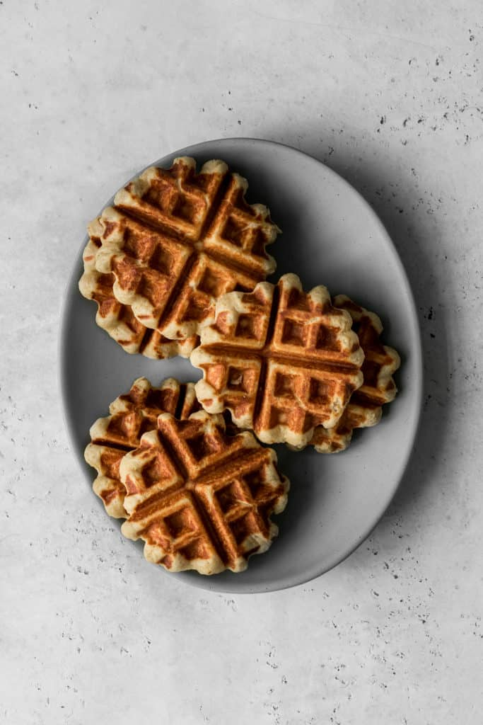 Oval plate with cooked Belgian-Style Waffle