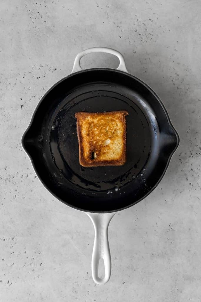 Toast frying in a cast iron skillet