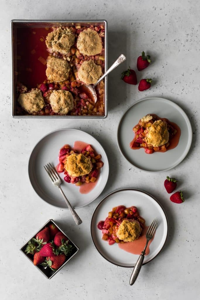 Strawberry Rhubarb Crisp being served on three dishes