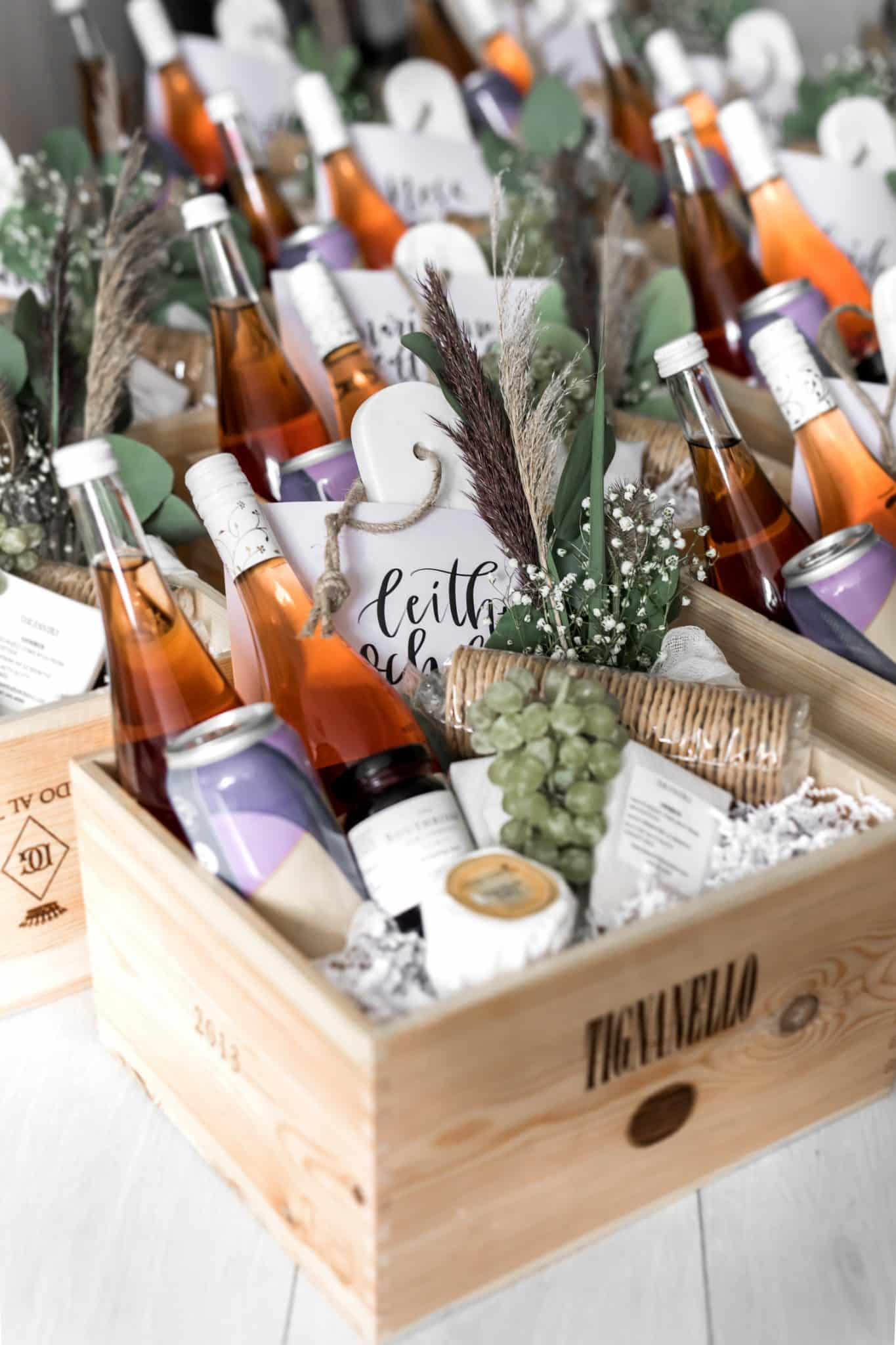 Wine crate with wine, beer, cheese, grapes, crackers and dried flowers for a virtual baby shower