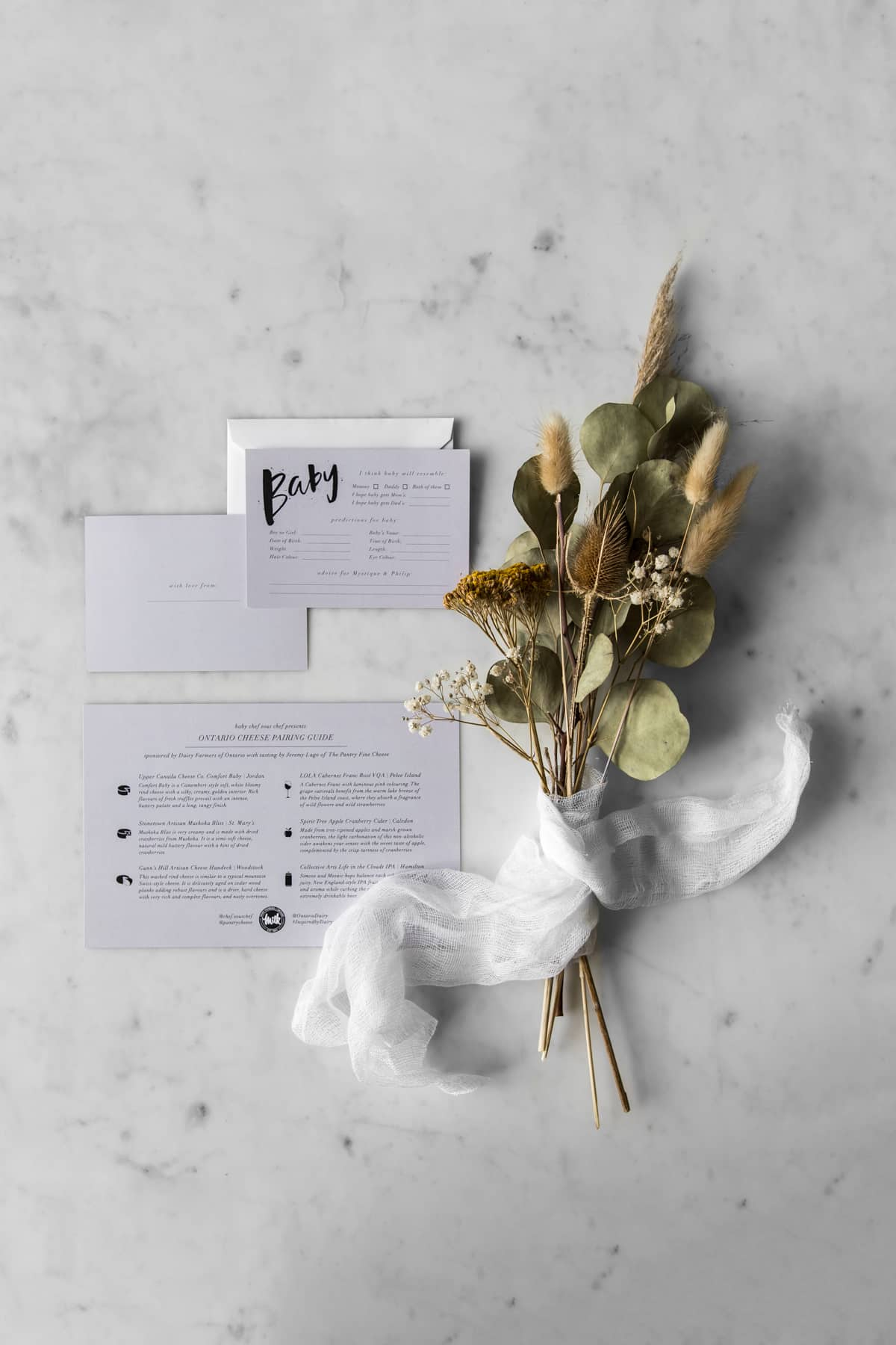 Dried flowers with virtual baby shower invitation and cheese pairing guide