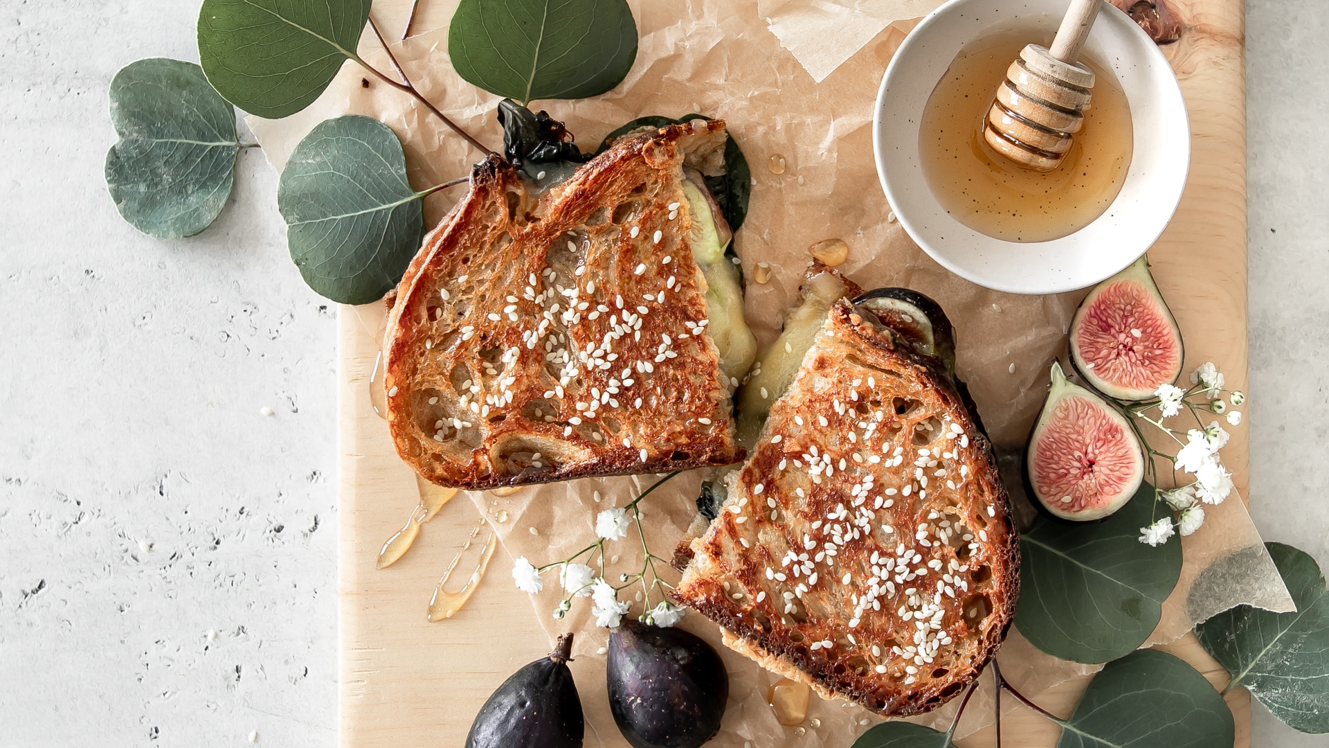 Gourmet grilled cheese sandwich with figs and honey