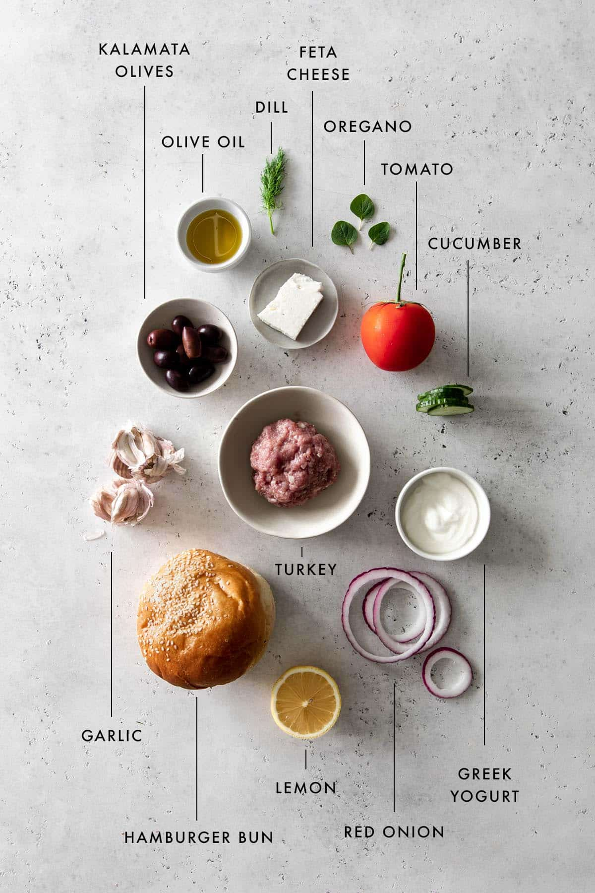 Flat lay style image of ingredients to make a greek burger