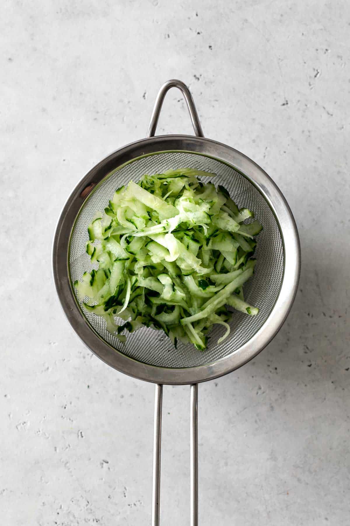 Grated cucumbers in a sieve