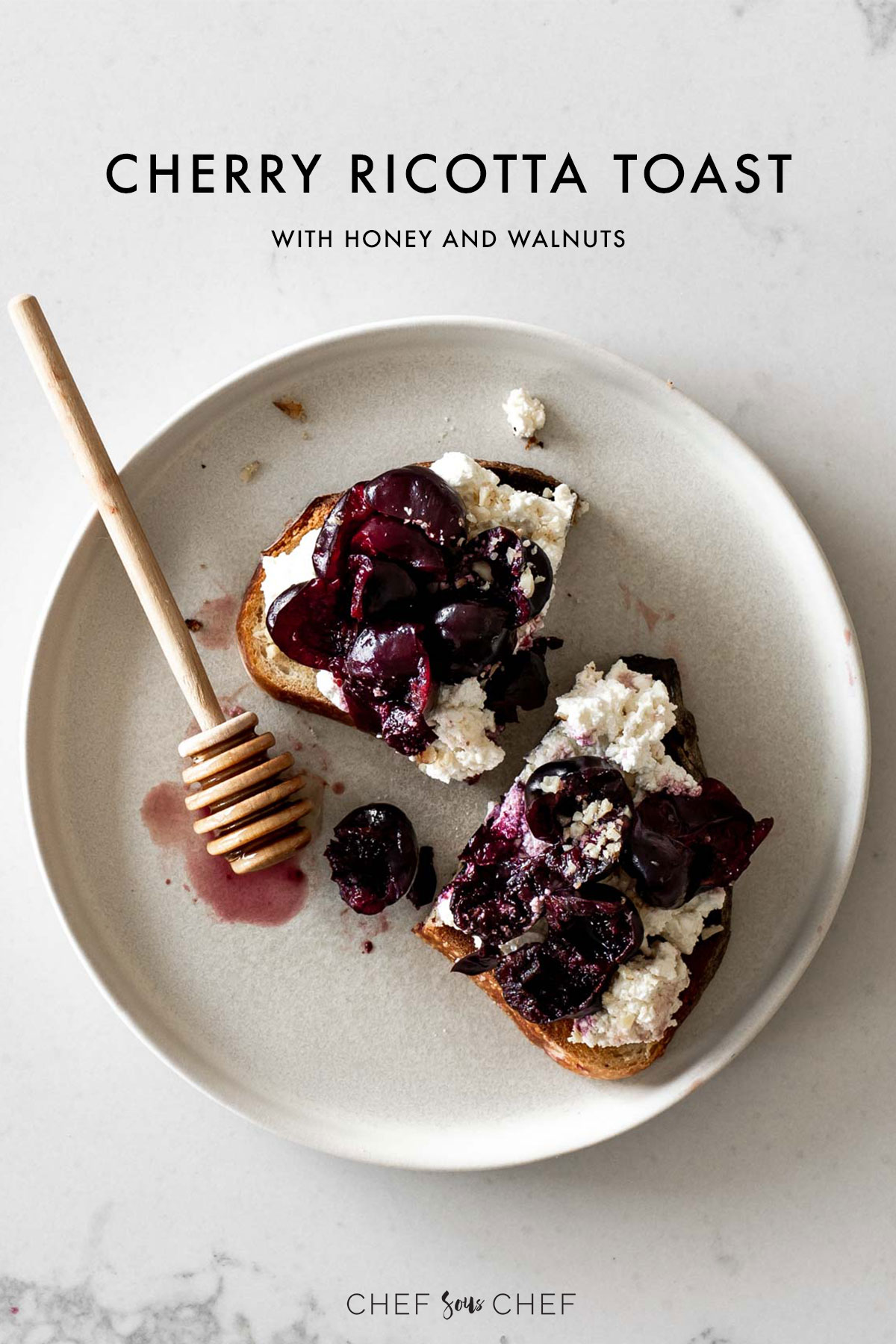 Ricotta Toast with Cherries on a Plate with a honey stick